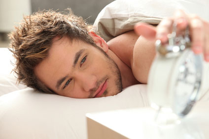 stockfresh_2172822_man-in-bed-turning-off-alarm_sizeXS_2a88a3